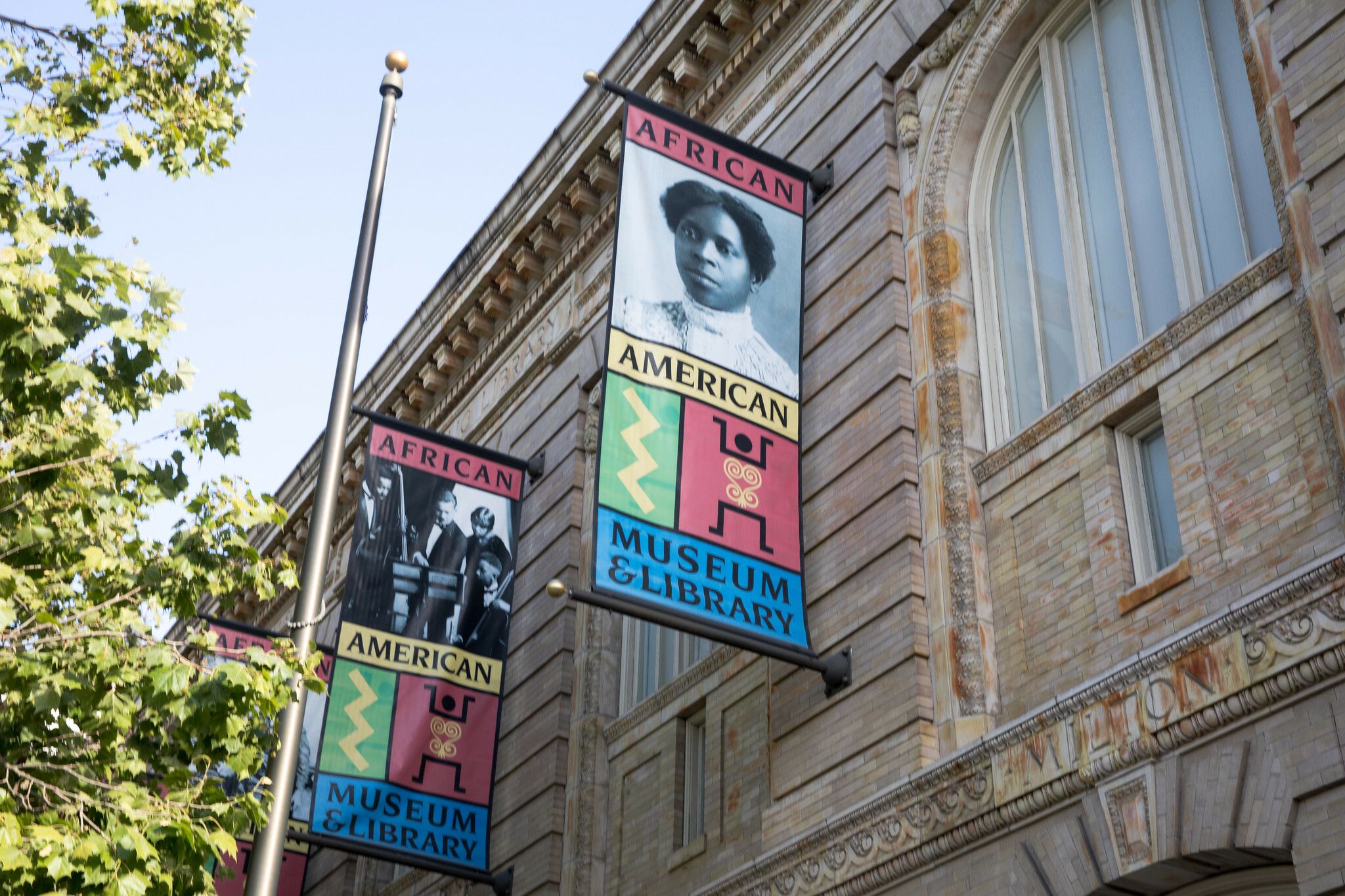 Colored banners advertising the African American Museum and Library at Oakland