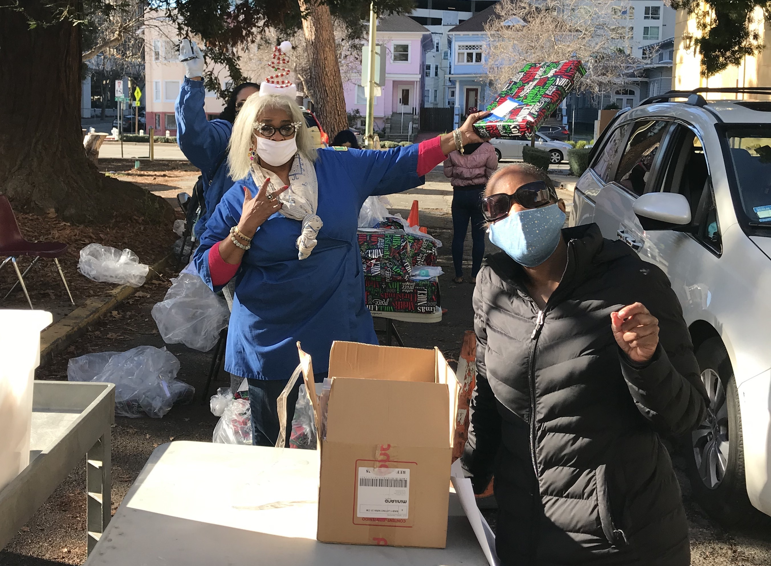 Photo of Head Start staff distributing gifts