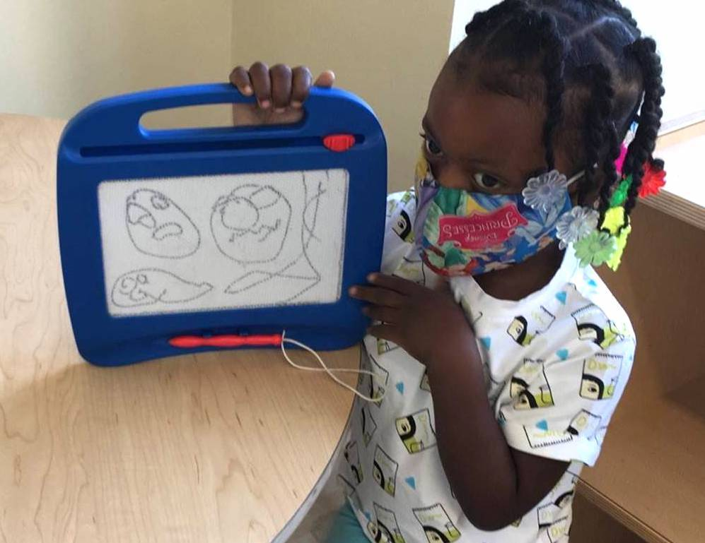 This Head Start student shows how learning can be fun and safe!