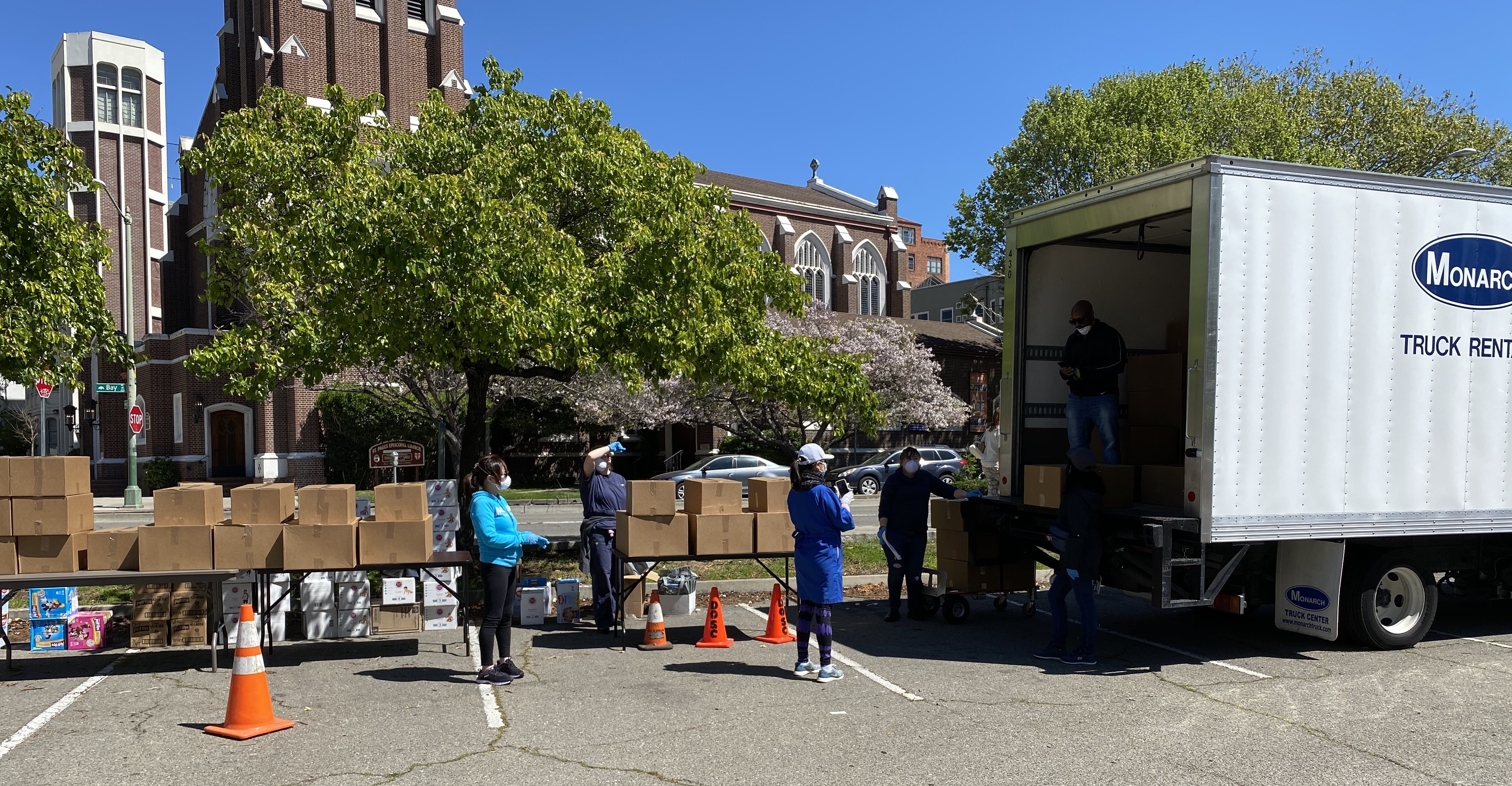 Head Start distributes food, diapers, and educational materials to families.