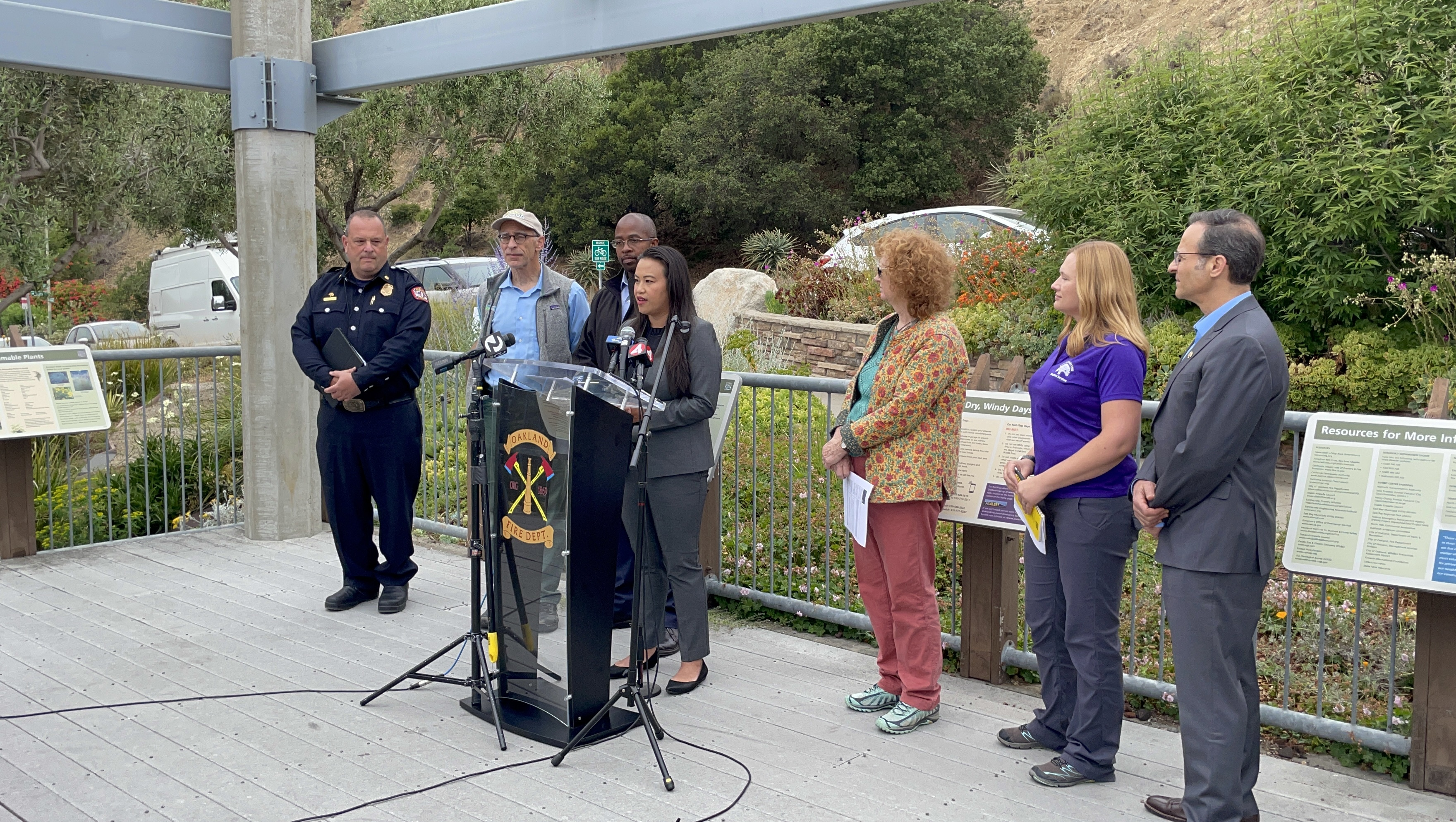 Councilmember Sheng Thao speaks at the site of the tunnel fire while surrounded by city staff and Councilmember's Kalb and Taylor