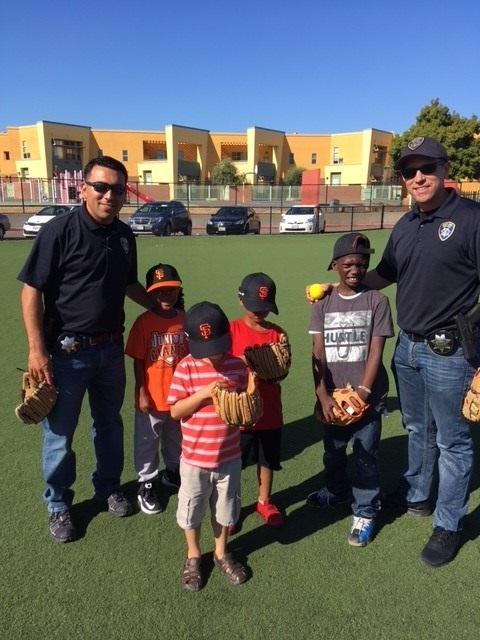 Officers Millan Estrada Cach Volunteer Baseball