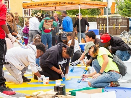 Photo of Paint the Town muralists at 90th and Plymouth