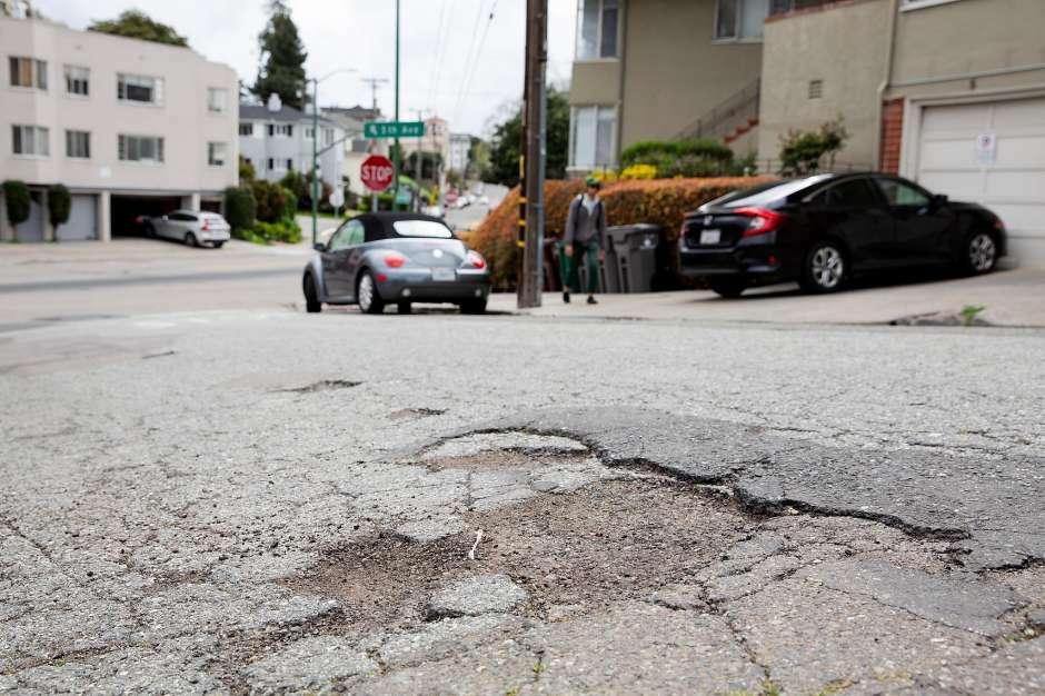 Closeup of a crack/pothole on Oakland streets
