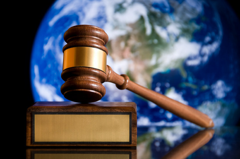 gavel with world behind