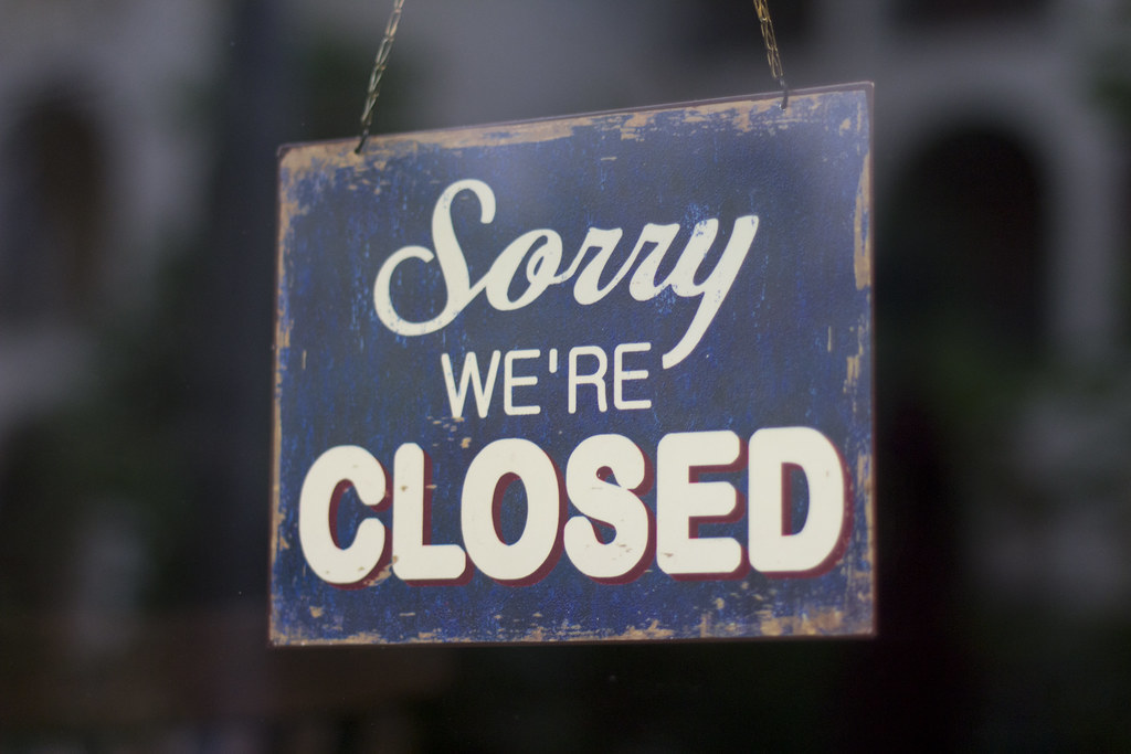 Picture of a sign that says, 'sorry we're closed'