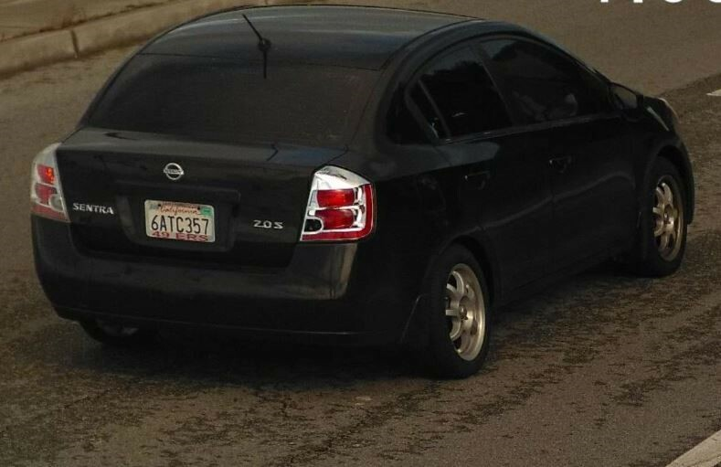 Photo of suspect vehicle wanted in attempted homicide. The suspect vehicle is a 2007 Nissan Sentra, black, 4-doors, tinted windows, custom rims, with a San Francisco 49er's license plate frame with CA license plate 6ATC357.
